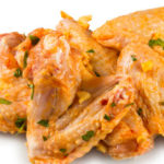 Marinated chicken wings over white background